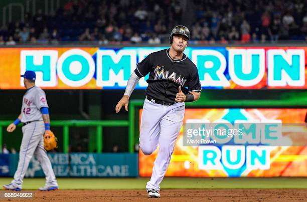 Justin Bour of the Miami Marlins hits a homerun in the second inning during the game between the Miami Marlins and the New York Mets at Marlins Park...