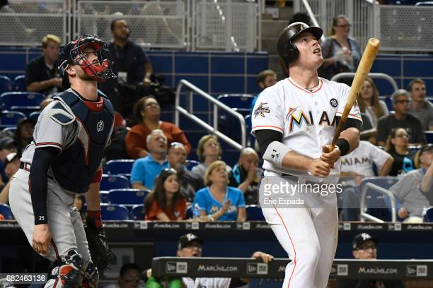 Justin Bour of the Miami Marlins hits a solo home run in the fourth inning against the Atlanta Braves at Marlins Park on May 12 2017 in Miami Florida