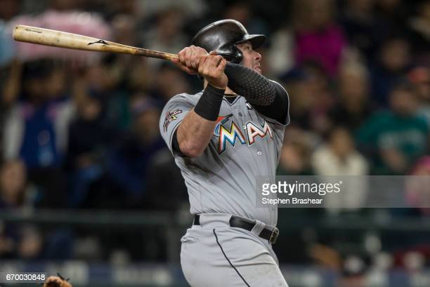 Justin Bour of the Miami Marlins hits a tworun home run off of starting pitcher Yovani Gallardo of the Seattle Mariners that scored Christian Yelich...
