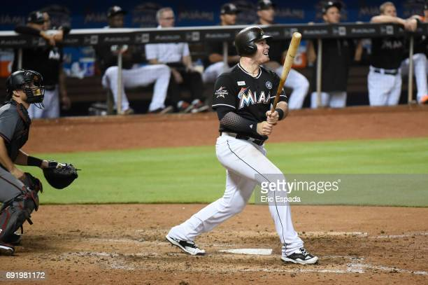 Justin Bour of the Miami Marlins hits an RBI double in the eighth inning against the Arizona Diamondbacks at Marlins Park on June 3 2017 in Miami...