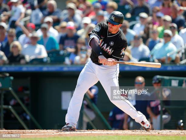 Justin Bour of the Miami Marlins in action against the Minnesota Twins during a spring training baseball game at Roger Dean Stadium on March 10 2017...