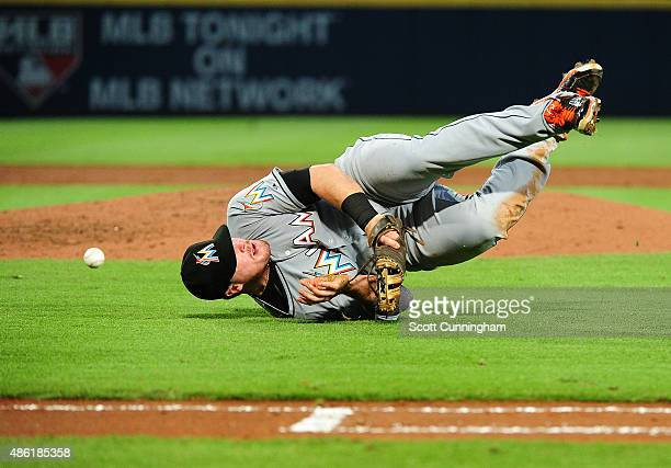 Justin Bour of the Miami Marlins is unable to make a diving catch on a bunt attempt by Sugar Ray Marimon during the third inning against the Atlanta...