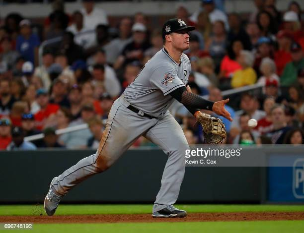 Justin Bour of the Miami Marlins makes a play on a ground out hit by Ender Inciarte of the Atlanta Braves in the sixth inning at SunTrust Park on...