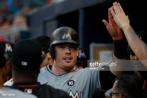 Justin Bour of the Miami Marlins reacts after hitting a solo homer in the fourth inning against the Atlanta Braves at SunTrust Park on June 16 2017...