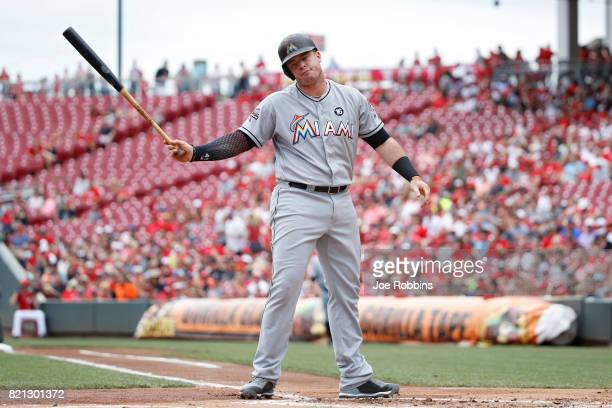 Justin Bour of the Miami Marlins reacts after striking out to end the first inning of a game against the Cincinnati Reds at Great American Ball Park...
