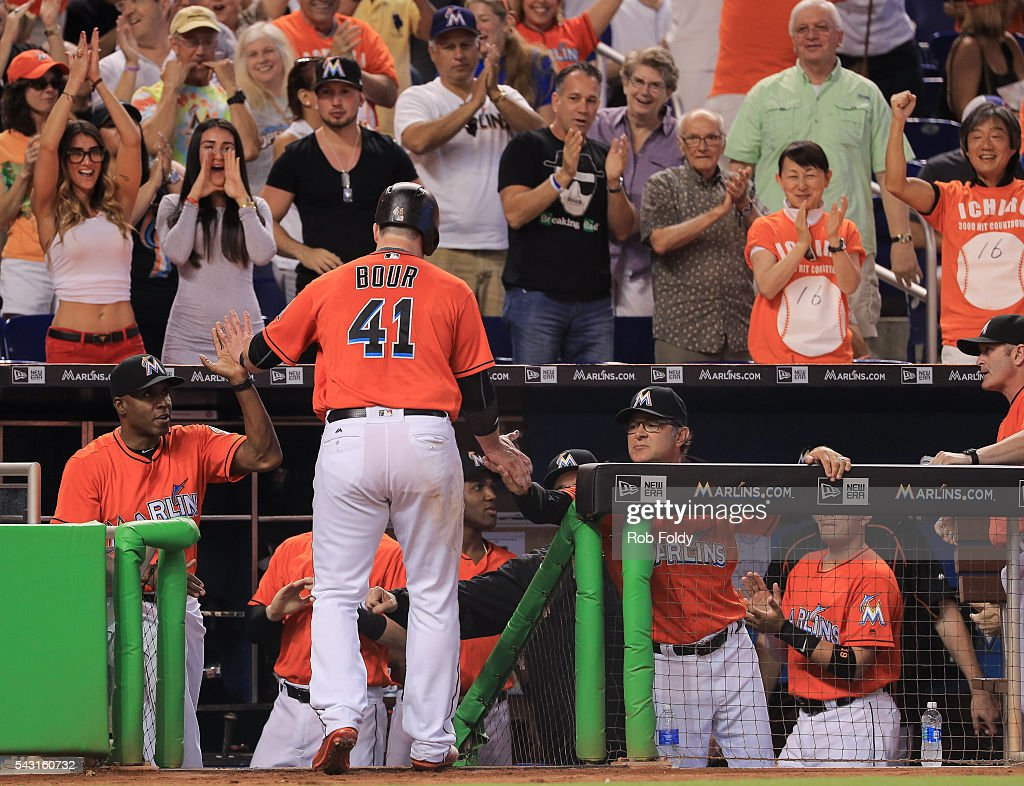 Justin Bour #41 of the Miami Marlins returns to the dugout after scoring a run on an RBI double by Derek Dietrich during the second inning of the game against the Chicago Cubs at Marlins Park on June 26, 2016 in Miami, Florida.