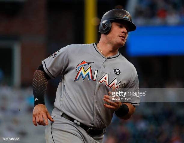 Justin Bour of the Miami Marlins rounds third base after hitting a solo homer in the fourth inning against the Atlanta Braves at SunTrust Park on...