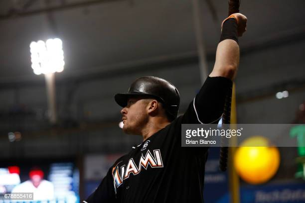 Justin Bour of the Miami Marlins warms up with a piece of rebar as he waits on deck to bat during the sixth inning of a game against the Tampa Bay...