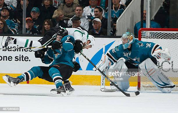 Justin Braun and Alex Stalock of the San Jose Sharks protect the net against Jamie Benn of the Dallas Stars during an NHL game on February 5 2014 at...