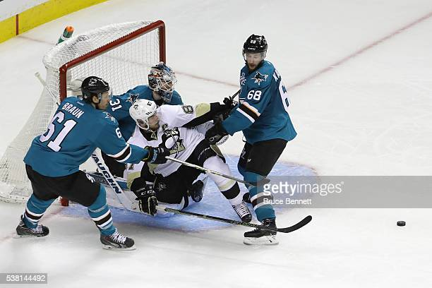 Justin Braun and Melker Karlsson of the San Jose Sharks combine on Sidney Crosby of the Pittsburgh Penguins in Game Three of the 2016 NHL Stanley Cup...