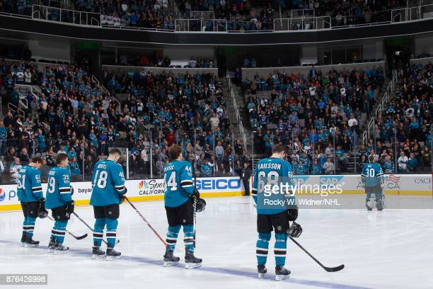 Justin Braun Logan Couture Tomas Hertl MarcEdouard Vlasic and Melker Karlsson of the San Jose Sharks stand for the national anthem of the game...