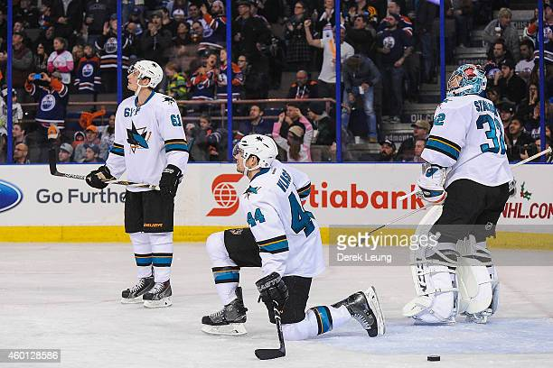 Justin Braun MarcEdouard Vlasic and Alex Stalock of the San Jose Sharks watch the replay after a goal by Nail Yakupov of the Edmonton Oilers during...