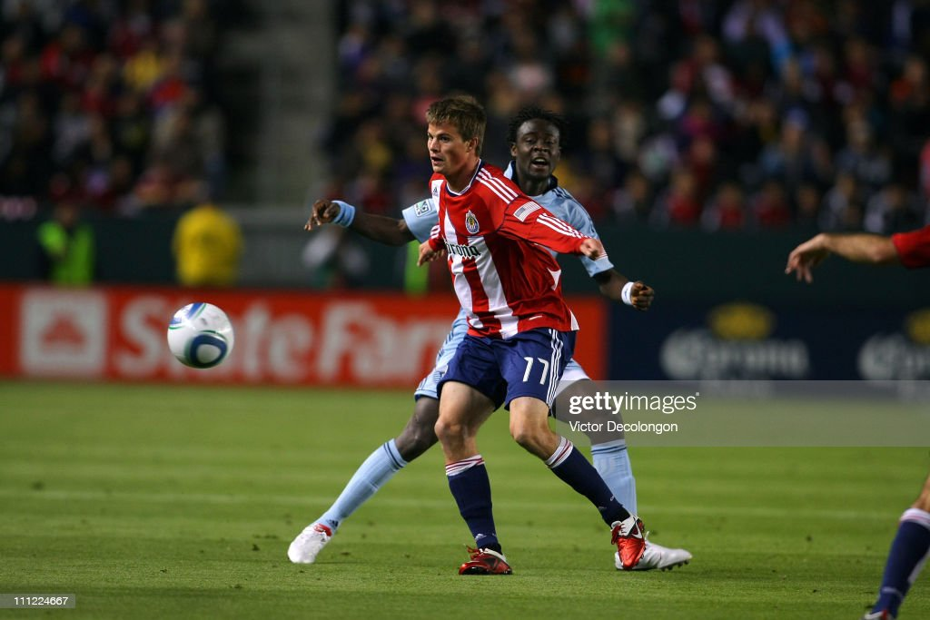 Justin Braun of Chivas USA wins the ball from Kei Kamara of Sporting Kansas City in the first half during the MLS match at The Home Depot Center on...