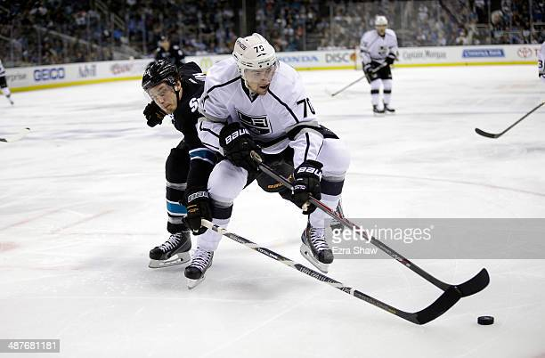 Justin Braun of the San Jose Sharks and Tanner Pearson of the Los Angeles Kings go for the puck in Game Seven of the First Round of the 2014 NHL...