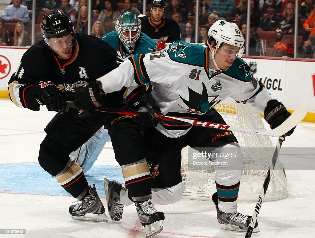Justin Braun #61 of the San Jose Sharks battles for position against <a gi-track='captionPersonalityLinkClicked' href=/galleries/search?phrase=Saku+Koivu&family=editorial&specificpeople=202253 ng-click='$event.stopPropagation()'>Saku Koivu</a> #11 of the Anaheim Ducks on March 25, 2013 at Honda Center in Anaheim, California.
