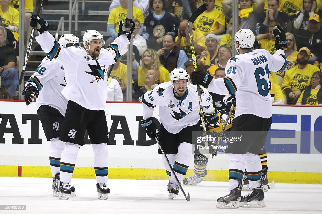 Justin Braun of the San Jose Sharks celebrates a third period goal with Logan Couture and Joonas Donskoi against the Pittsburgh Penguins in Game Two...