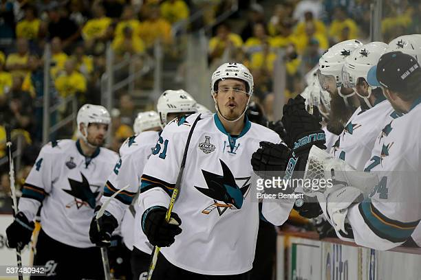 Justin Braun of the San Jose Sharks celebrates a third period goal against the Pittsburgh Penguins with teammates in Game Two of the 2016 NHL Stanley...