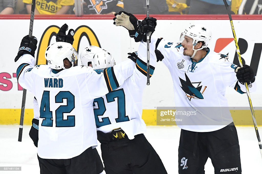 Justin Braun of the San Jose Sharks celebrates with teammates after scoring a third period goal against Matt Murray of the Pittsburgh Penguins in...
