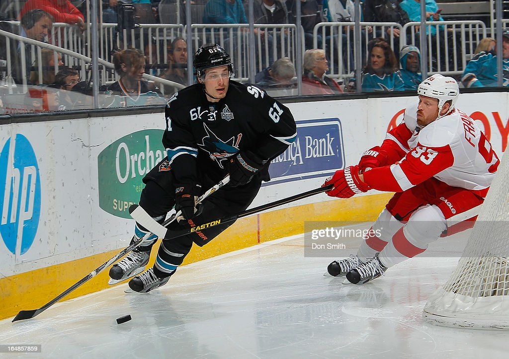 Justin Braun #61 of the San Jose Sharks is chased by <a gi-track='captionPersonalityLinkClicked' href=/galleries/search?phrase=Johan+Franzen&family=editorial&specificpeople=624356 ng-click='$event.stopPropagation()'>Johan Franzen</a> #93 of the Detroit Red Wings during an NHL game on March 28, 2013 at HP Pavilion in San Jose, California.