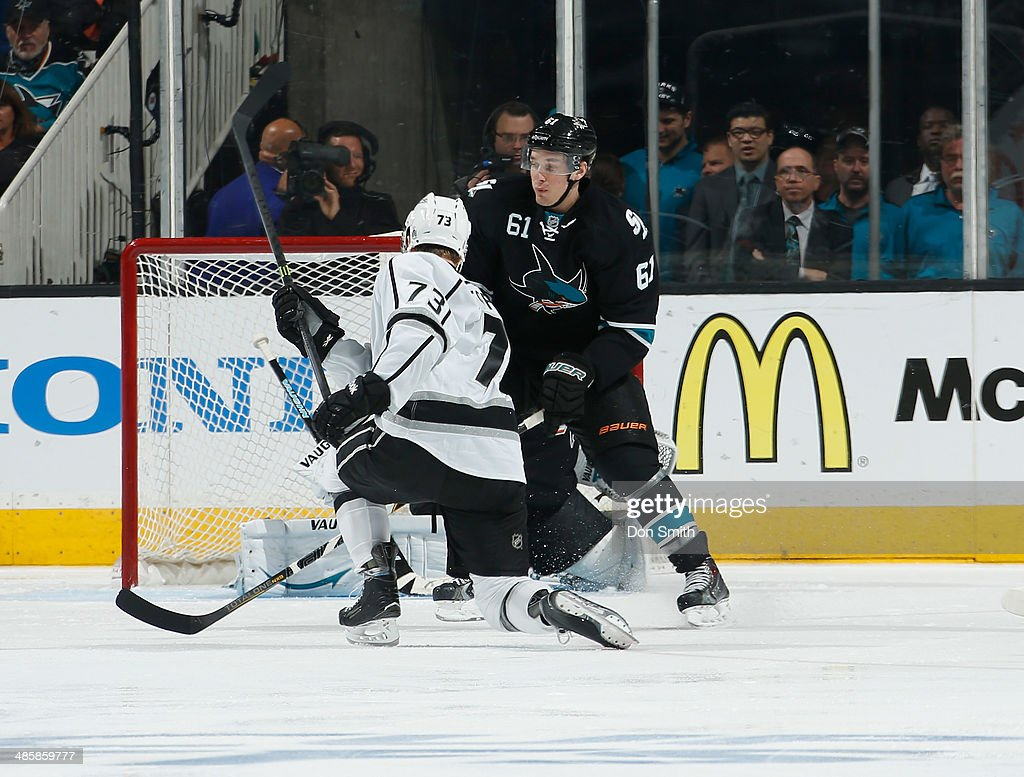 Justin Braun #61 of the San Jose Sharks tries to block a shot against Tyler Toffoli #73 of the Los Angeles Kings in Game Two of the First Round of the 2014 Stanley Cup Playoffs at SAP Center on April 20, 2014 in San Jose, California.