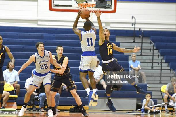 Justin Bridges of the Chaminade Silverswords takes a jump shot over Don Coleman of the California Golden Bears during a consultation college...