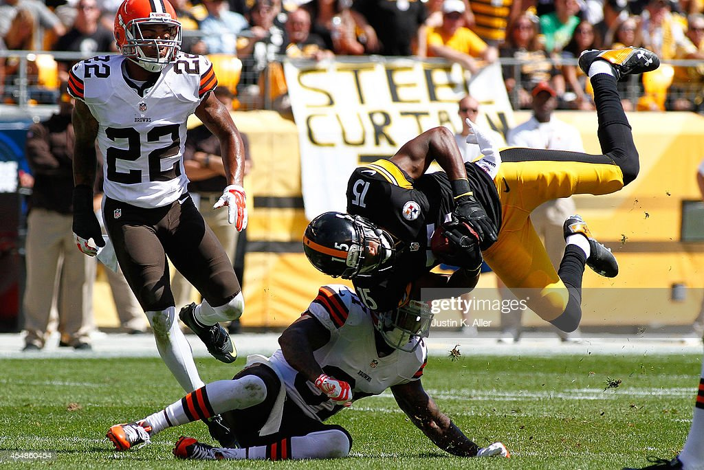 Justin Brown #15 of the Pittsburgh Steelers gets up ended by <a gi-track='captionPersonalityLinkClicked' href=/galleries/search?phrase=Donte+Whitner&family=editorial&specificpeople=649027 ng-click='$event.stopPropagation()'>Donte Whitner</a> #31 of the Cleveland Browns during the second quarter at Heinz Field on September 7, 2014 in Pittsburgh, Pennsylvania.