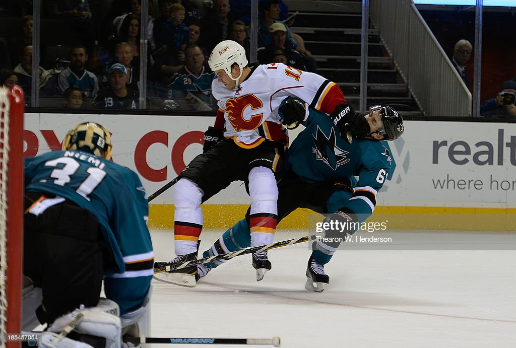 Justin Bruan #61 of the San Jose Sharks collides with <a gi-track='captionPersonalityLinkClicked' href=/galleries/search?phrase=Lance+Bouma&family=editorial&specificpeople=4303790 ng-click='$event.stopPropagation()'>Lance Bouma</a> #17 of the Calgary Flames during the third period at SAP Center on October 19, 2013 in San Jose, California.