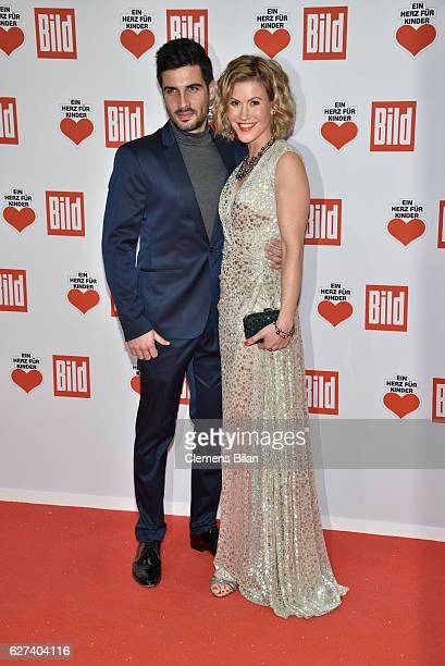 Justin Bryan and Wolke Hegenbarth attend the Ein Herz Fuer Kinder Gala 2016 on December 3 2016 in Berlin Germany