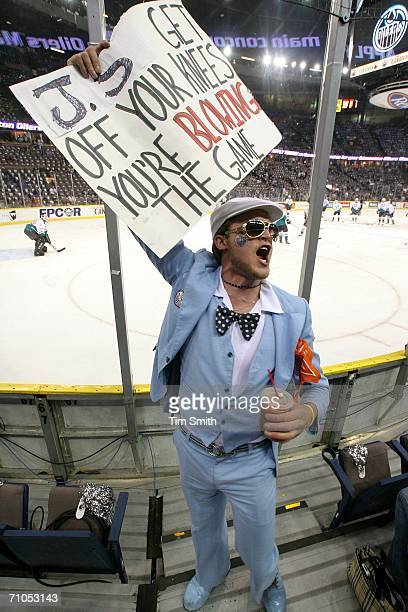 Justin Cider a fan of the Edmonton Oilers holds a sign prior to the 2006 NHL Playoff game four of the Western Conference Finals between the Mighty...