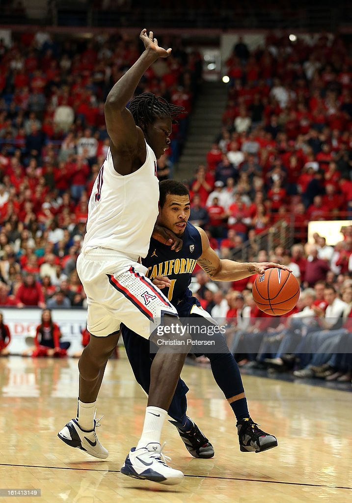 Justin Cobbs #1 of the California Golden Bears handles the ball guarded by Angelo Chol #30 of the Arizona Wildcats during the college basketball game at McKale Center on February 10, 2013 in Tucson, Arizona. The Golden Bears defeated the Wildcats 77-69.
