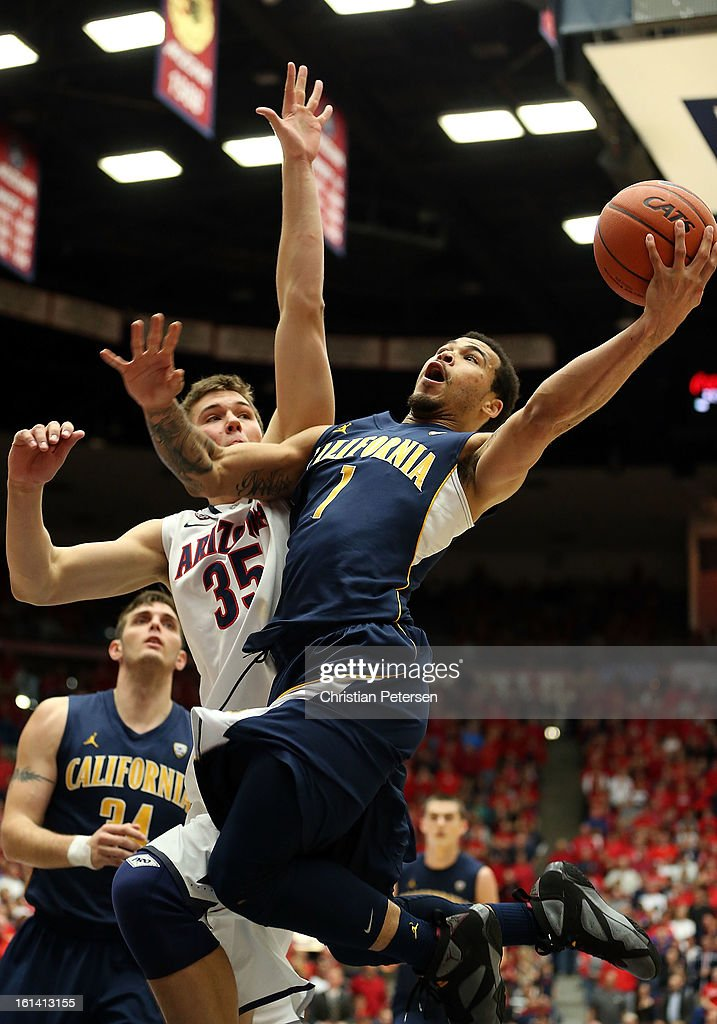 Justin Cobbs #1 of the California Golden Bears lays up a shot past <a gi-track='captionPersonalityLinkClicked' href=/galleries/search?phrase=Kaleb+Tarczewski&family=editorial&specificpeople=8047518 ng-click='$event.stopPropagation()'>Kaleb Tarczewski</a> #35 of the Arizona Wildcats during the college basketball game at McKale Center on February 10, 2013 in Tucson, Arizona. The Golden Bears defeated the Wildcats 77-99.
