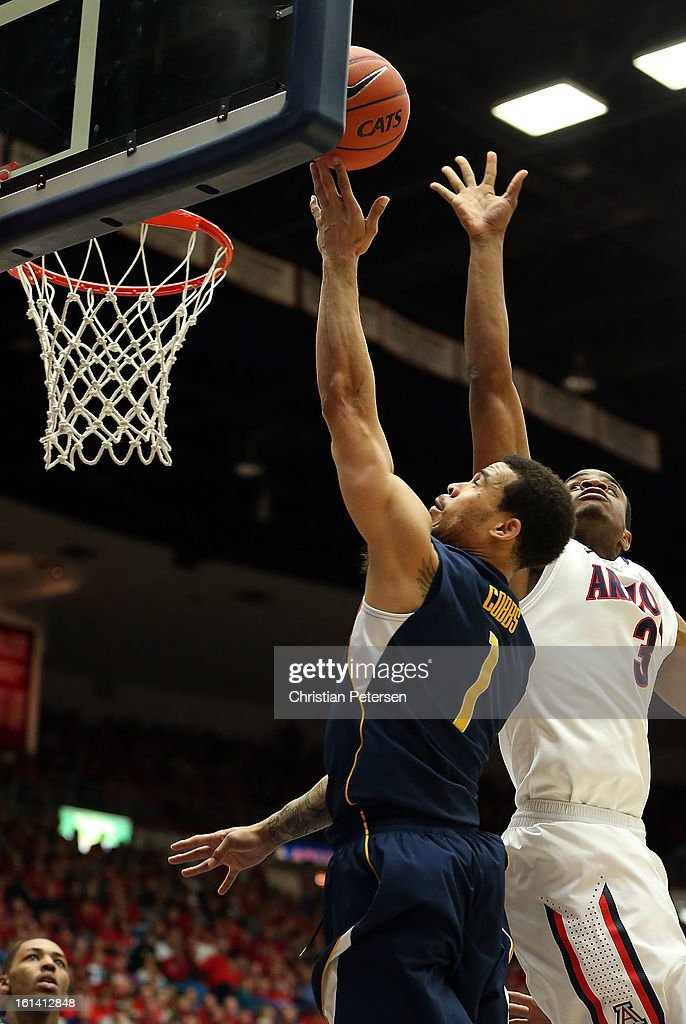 Justin Cobbs #1 of the California Golden Bears lays up a shot past Kevin Parrom #3 of the Arizona Wildcats during the college basketball game at McKale Center on February 10, 2013 in Tucson, Arizona. The Golden Bears defeated the Wildcats 77-99.