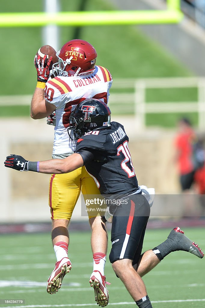 Justin Coleman #80 of the Iowa State Cyclones catches a pass while being defended Tanner Jackson #20 of the Texas tech Red Raiders during game action on October 12, 2013 at AT&T Jones Stadium in Lubbock, Texas. Texas Tech won the game over Iowa State 42-35.