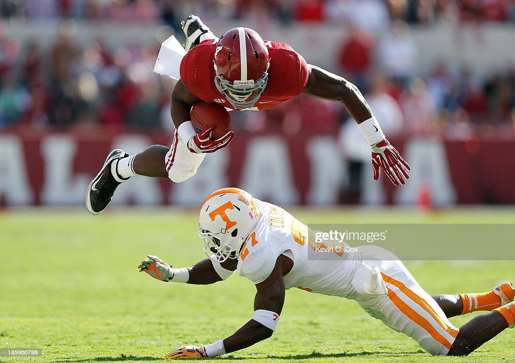Justin Coleman #27 of the Tennessee Volunteers upends <a gi-track='captionPersonalityLinkClicked' href=/galleries/search?phrase=T.J.+Yeldon&family=editorial&specificpeople=9688955 ng-click='$event.stopPropagation()'>T.J. Yeldon</a> #4 of the Alabama Crimson Tide at Bryant-Denny Stadium on October 26, 2013 in Tuscaloosa, Alabama.