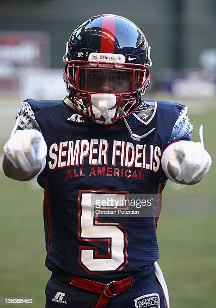 Justin Combs of the East Team stand on the field for introductions to the Semper Fidelis AllAmerican Bowl against the West Team at Chase Field on...