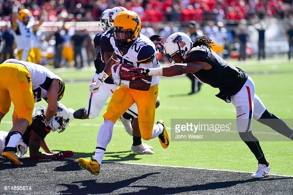 Justin Crawford of the West Virginia Mountaineers scores touchdown against the Texas Tech Red Raiders during the game on October 15 2016 at ATT Jones...