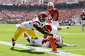 Justin Davis of the USC Trojan dives for the endzone against the Stanford Cardinal at Stanford Stadium on September 6 2014 in Palo Alto California He...