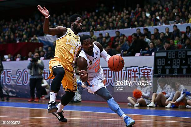 Justin Dentmon of Sichuan Blue Whales drives the ball against Jeremy Pargo of Zhejiang Lions during the Chinese Basketball Association 15/16 season...