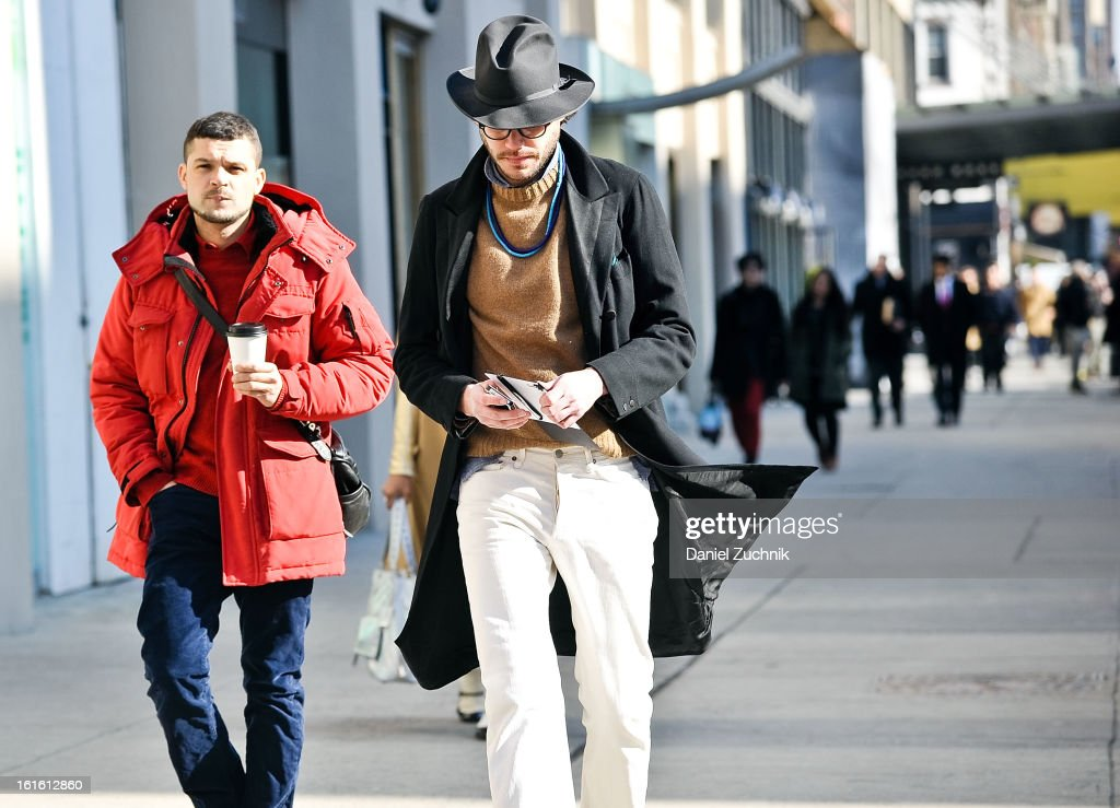 Justin Doss(R) seen arriving to the Perry Ellis by Duckie Brown show on February 12, 2013 in New York City.
