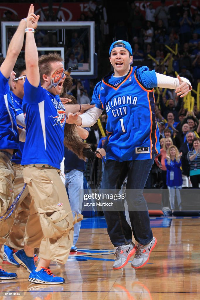 Justin Dougherty hits the Mid First Bank half court shot for $20,000 during the Oklahoma City Thunder game where they played the Portland Trail Blazers on March 24, 2013 at the Chesapeake Energy Arena in Oklahoma City, Oklahoma.