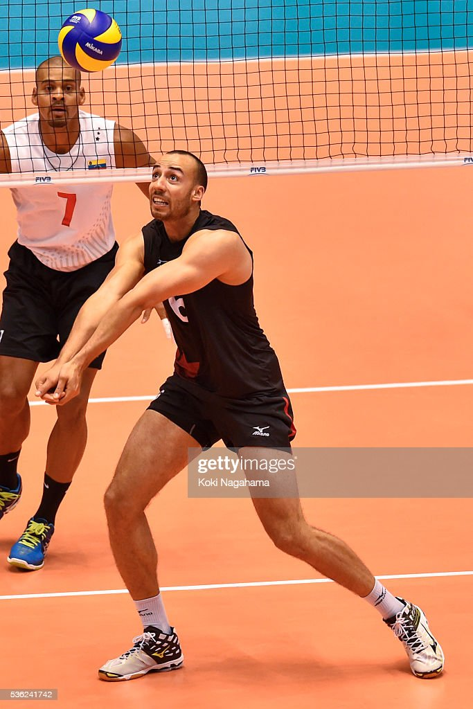 Justin Duff #6 of Canada receives the ball during the Men's World Olympic Qualification game between Venezuela and Canada at Tokyo Metropolitan Gymnasium on June 1, 2016 in Tokyo, Japan.