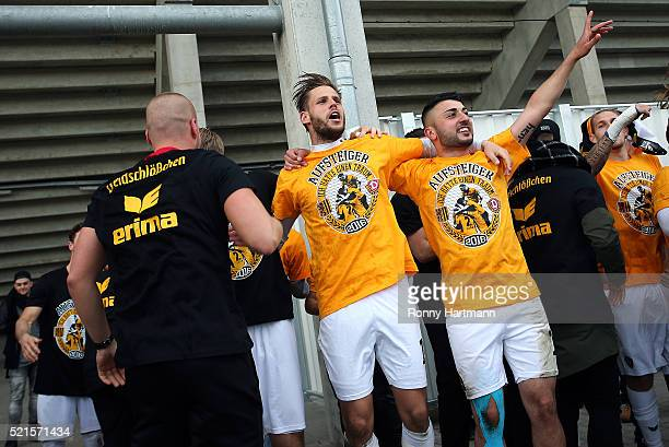 Justin Eilers and Aias Aosman of Dresden celebrate after the Third League match between 1 FC Magdeburg and Dynamo Dresden at MDCCArena on April 16...