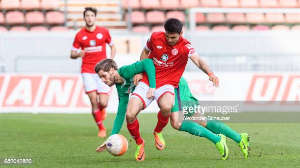 Justin Eilers of Bremen challenges Gerrit Holtmann of Mainz during the Third League match between Mainz 05 II and SV Werder Bremen II at Bruchweg...