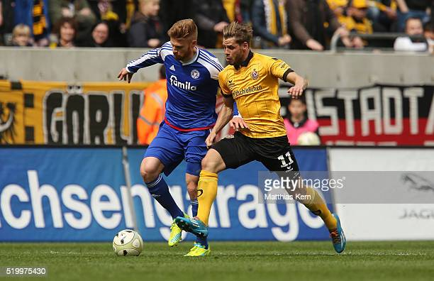 Justin Eilers of Dresden battles for the ball with Mathias Fetsch of Kiel during the third league match between SG Dynamo Dresden and Holstein Kiel...