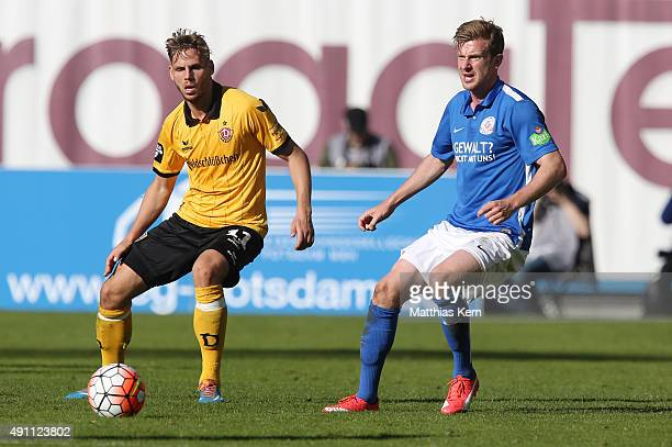 Justin Eilers of Dresden battles for the ball with Maximilian Ahlschwede of Rostock during the third league match between FC Hansa Rostock and SG...