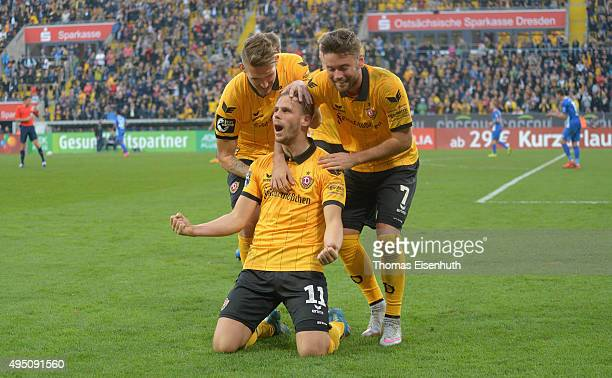 Justin Eilers of Dresden celebrates after scoring 31 with Robert Andrich and Niklas Kreuzer during the Third League match between SG Dynamo Dresden...