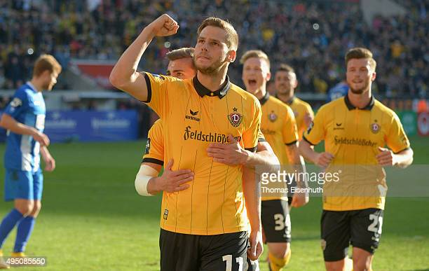 Justin Eilers of Dresden celebrates after scoring the opening goal with teammate Sinan Tekerci during the Third League match between SG Dynamo...