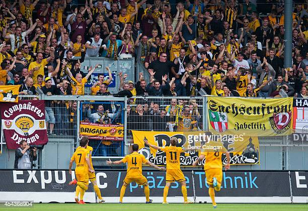 Justin Eilers of Dresden celebrates his first goal for his team in front of the Dynamo Dresden supporters with his teammates Niklas Kreuzer of...
