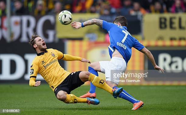 Justin Eilers of Dresden is challenged by Christian Dorda of Rostock during the Third League match between SG Dynamo Dresden and FC Hansa Rostock at...