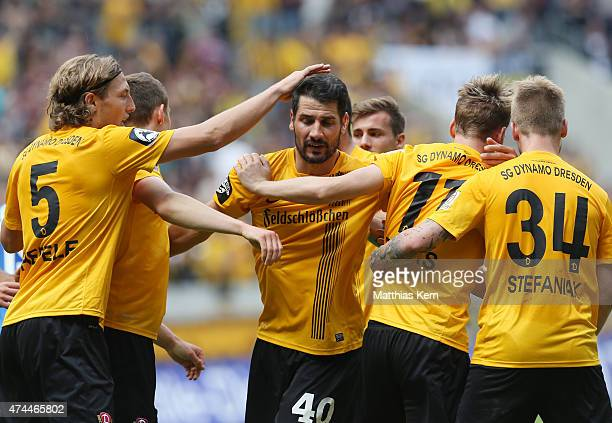 Justin Eilers of Dresden jubilates with team mates after scoring the second goal during the third league match between SG Dynamo Dresden and FC Hansa...